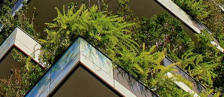 Building in Italy with trees and plants on balconies