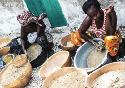 Women on Fadiouth Island in Senegal prepare millet, a locally grown food staple, to make couscous.